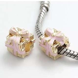 Gold Present Light Pink Ribbon Charm