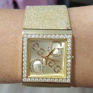 Guess gold watch with material glitter band