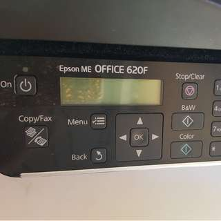Epson. Can print and copy document. Includes cable to laptop and charger.