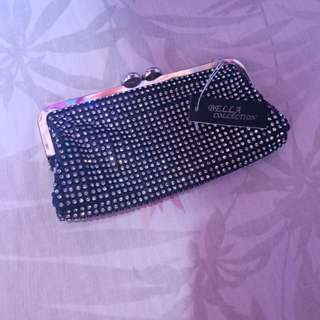 Clutch with glitters