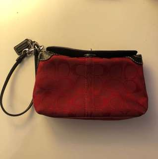 Red and brown Coach wristlet
