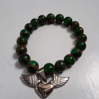 Emerald bracelet and heart with wings charm