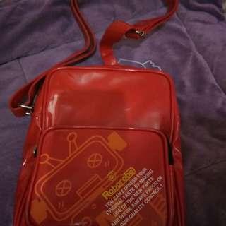 Roborobo red sling bag