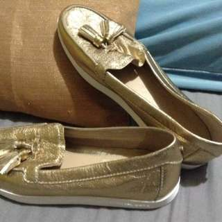 Size 7 Michael Kors gold boat shoes authentic