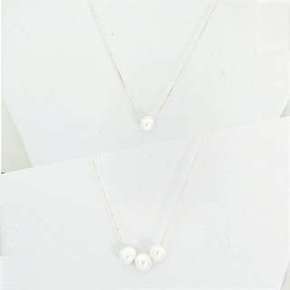 Floating Ivory Pearl Necklace