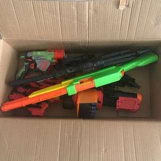 Box of Nerf Guns and toy guns