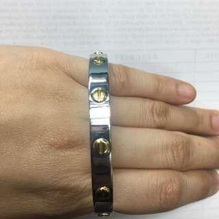 Two tone large cartier bangle