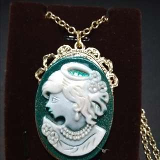 Green cameo lady in gold settings