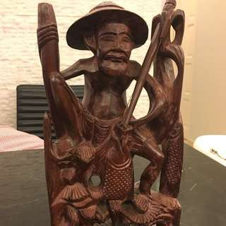 Vintage Asian Fisherman Wood Carving Statute acquired from Bali