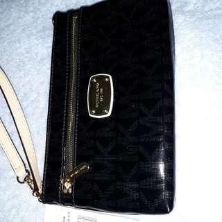 Mk wrislet wallet authentic