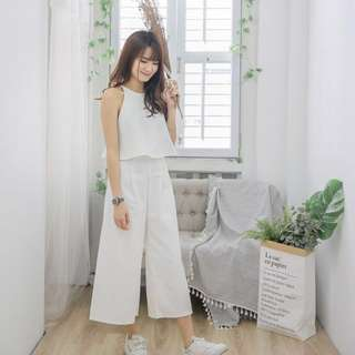 plain white sleeveless top and culottes set