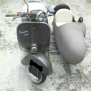 Vespa with sidecar vintage