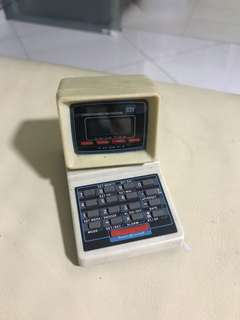 early 80s calculator w pencil sharperner shaped of pc
