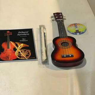 Ochestral instruments book with CD and Recorder and toy ukelele with CD