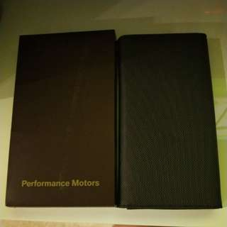 Performance Motors parking coupons and cards organizer