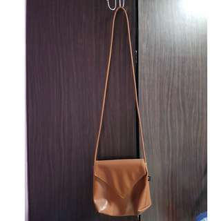 Ladies brown sling bag