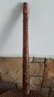 Wooden candle stick like carving