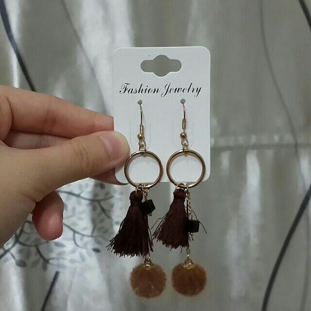 Brown long earrings