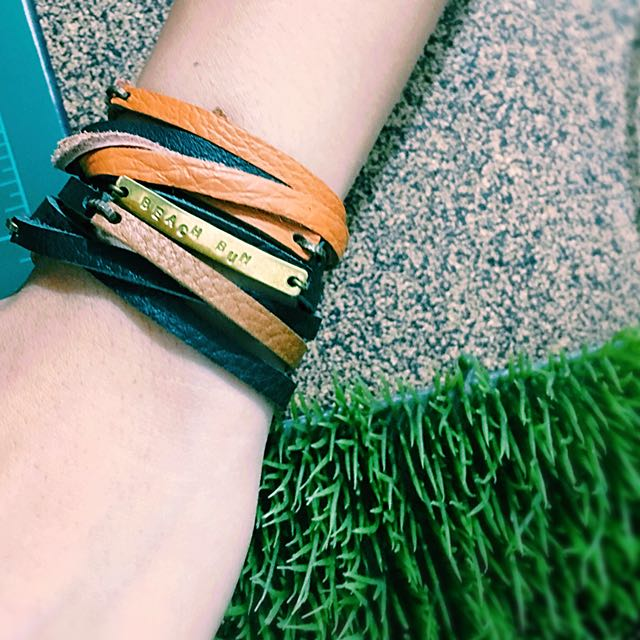 Handmade leather wrap bracelet with hand stamped raw brass tag.