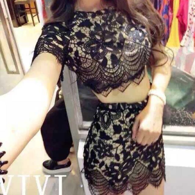 Set wear black lace top and skirt