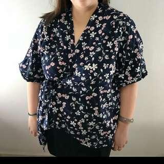 Plus size floral wraparound top