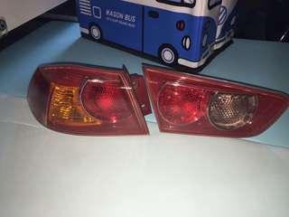 Lampu merah belakang lancer Gt inspira evo x
