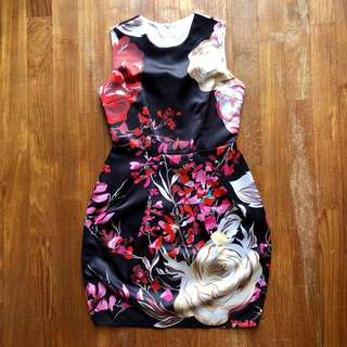 Black short-sleeved dress with red flower print and asymmetrical pleats