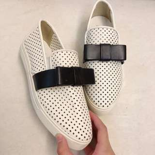 White Slip Ons with Black Ribbon