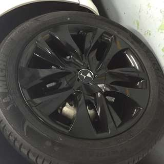 Glossy black rim spray service