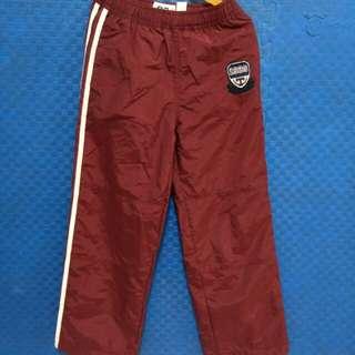 酒紅色防風潑水雙層運動風休閒褲