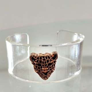 Acrylic cuff with black/gold leopard centrepiece