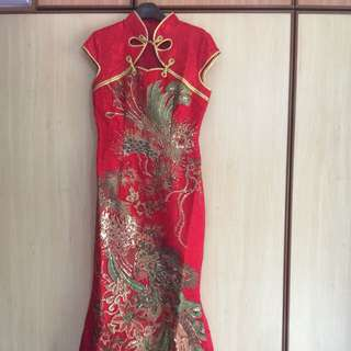 A preloved grand-looking QiPao for sale