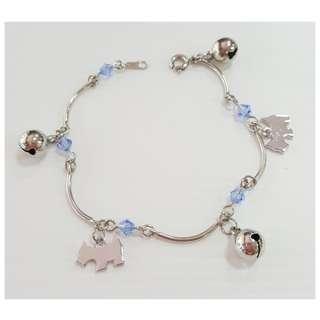 Dangling bracelet with Swarovski colour crystals & doggy ornaments & bells.