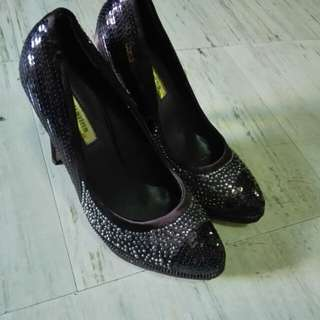 Brown studded high heeled shoes