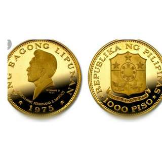 Looking marcos and isabel gold coin