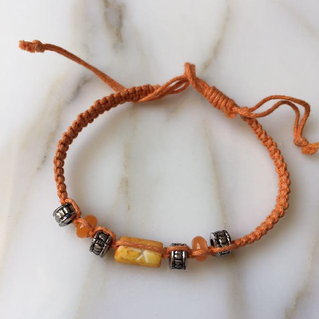 **free with $10+ purchase** Yellow orange bracelet