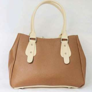 Xia (brown with white handle)
