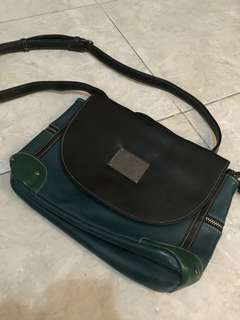 Green and black sling bag