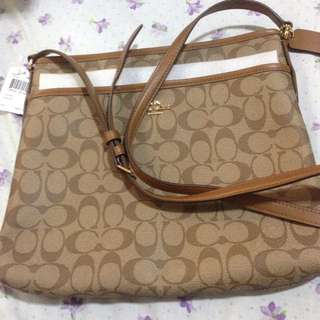 Authentic coach brand new from us..