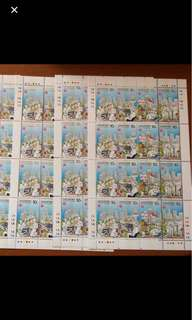 Singapore NTUC stamp sheet ($4 per sheet) - very slight tinged gum