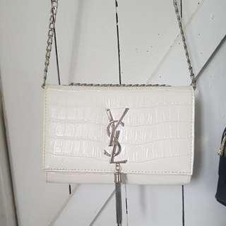 Ysl crossbody clutch bag with tassel