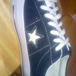 Converse all star shoes .