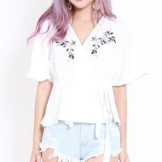 White Embroidered wrap flutter self-tie Top