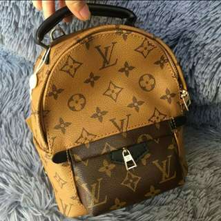 lv backpack palm spring mini