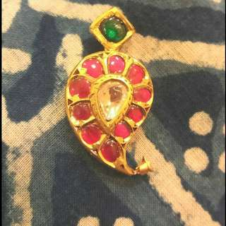 Ruby ,uncut diamond and emerald pendant.
