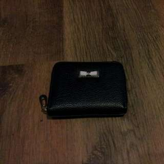 black wallet with small ribbon