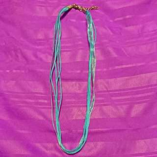 Blue ribbon and lines necklace for gala night