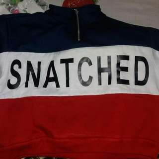 Sweater 'Snatched'.