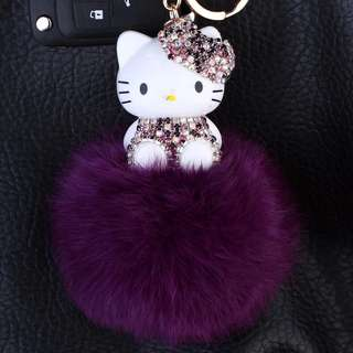 Hello kitty purple fur ball keychain