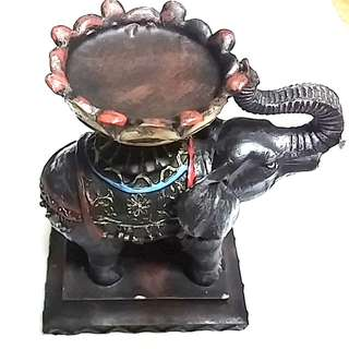 Black fibre elephant with a large disk hard resin